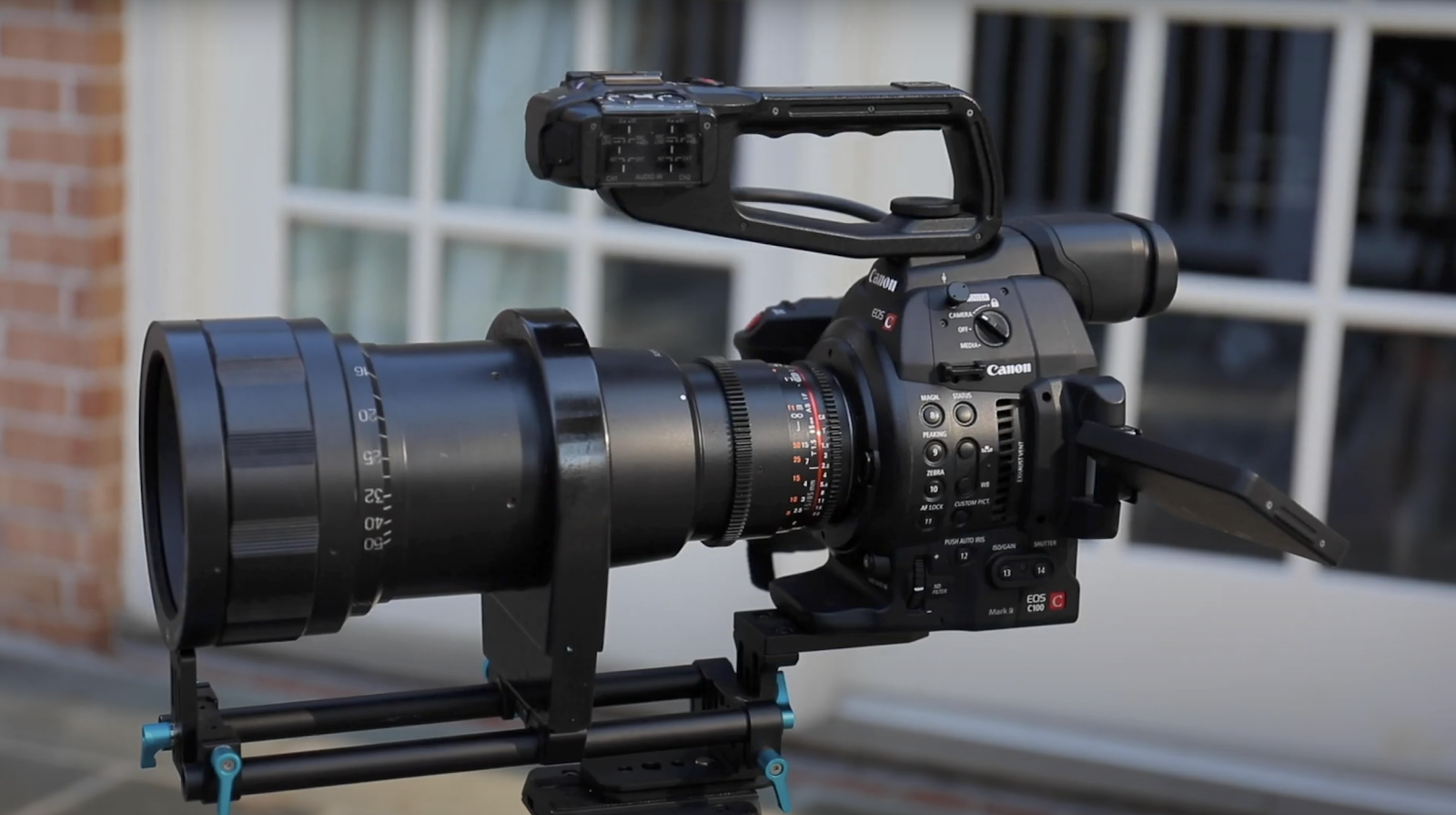 Camera on tripod with anamorphic lens
