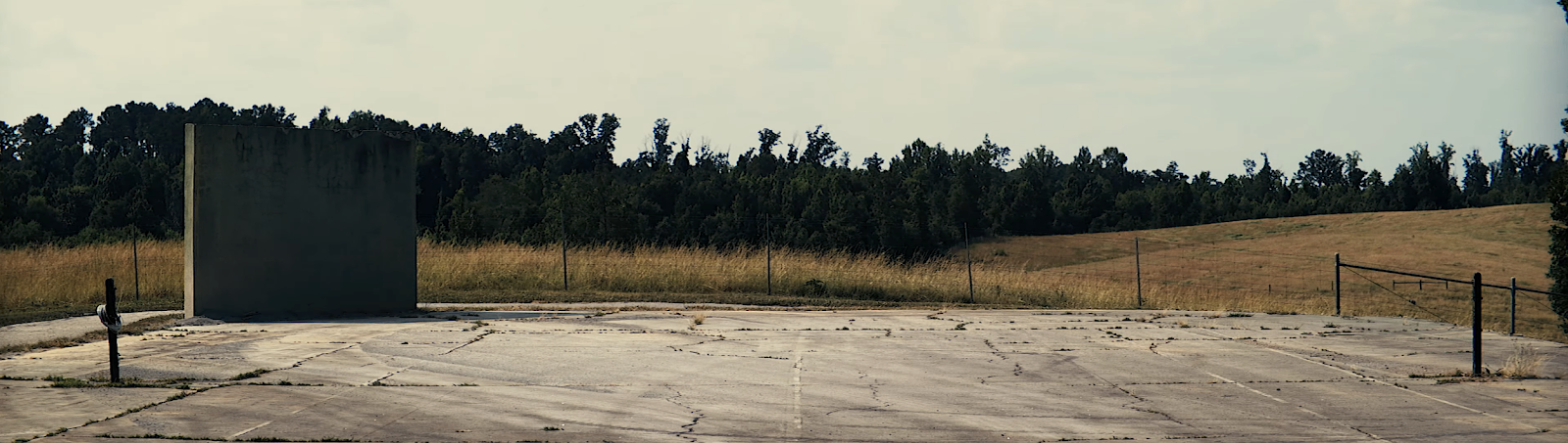 Wide frame image of abandoned lot in a field