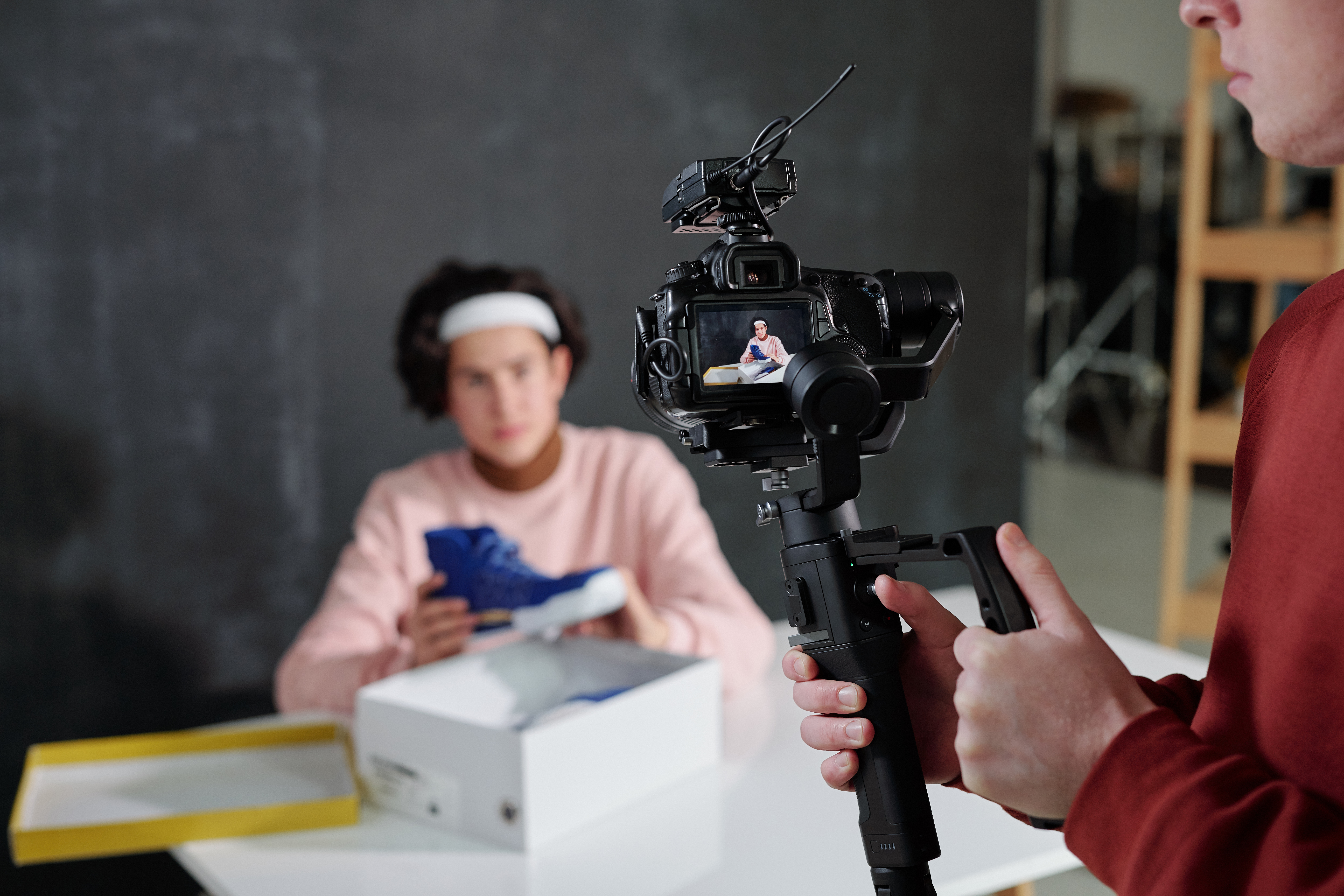 Person holding product to use in promotional video.